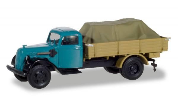 310291 - Herpa - Ford V 3000 2achs Pritschen-LKW mit Ladung, blau/braun