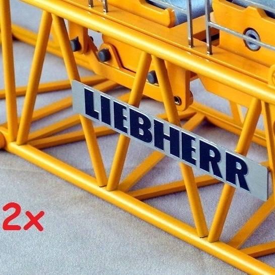 YC667A - LR 1750 Metall Logo Liebherr - 2 Stück -