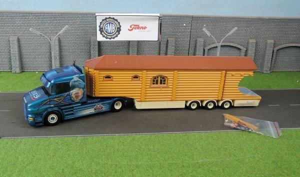 67539 - Tekno - Scania T Hauber mit Blockhausauflieger - Niedergesaess -